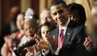 President Barack Obama applauds as he attends the National Prayer Breakfast in Washington, Thursday, Feb. 5, 2009.