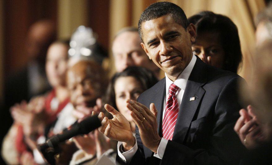 President Barack Obama applauds as he attends the National Prayer Breakfast in Washington, Thursday, Feb. 5, 2009.