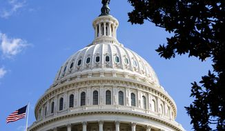 ** FILE ** The American flag flies above the U.S. Capitol. (AP Photo)