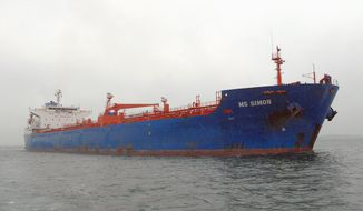 In this file photo from 2007, the oil tanker MS Simon enters Boston Harbor on Dec. 10, 2007, carrying low-cost heating oil from Venezuela, to be distributed to low-income households in the United States at a 40 percent discount. (Getty Images photographs)