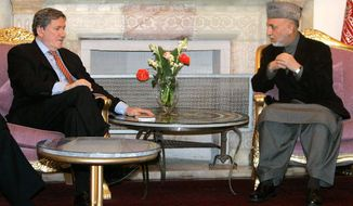 ** FILE ** Richard C. Holbrooke (left), the U.S. envoy to Afghanistan and Pakistan meets with Afghan President Hamid Karzai in February 2009 as tensions over civilian casualties strain relations between the two countries. (Associated Press)
