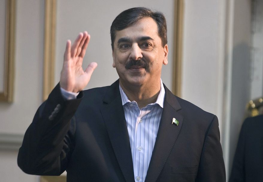 "Pakistani Prime Minister Yousuf Raza Gilani waves to the media upon his arrival for a press conference in Islamabad, Pakistan, on Sunday, Feb. 1, 2009. Mr. Gilani said that military action ""is not the only solution"" to the brutal insurgency in the Swat Valley, an indication that negotiations may still be an option despite a failed past peace deal in the one-time tourist haven. (AP Photo/Anjum Naveed)"