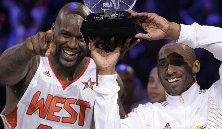 Western All-Star Shaquille O'Neal (32) of the Phoenix Suns and Western All-Star Kobe Bryant (24) of the Los Angeles Lakers share the MVP award after the NBA All-Star basketball game Sunday, Feb. 15, 2009, in Phoenix. Associated Press.