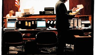 A lawyer reviews his notes during a lunch break in a trial. Maya Alleruzzo/ The Washington Times.