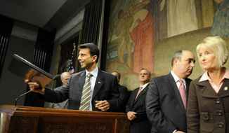Louisiana Gov. Bobby Jindal, joined by several legislators including Speaker of The House Jim Tucker, R-Terrytown, second from right, and Rep. Jane Smith, R-Bossier City, far right, exits a news conference at the State Capitol in Baton Rouge, La. Wednesday, Feb. 18, 2009. Jindal is among a handful of Republican governors are considering turning down some money from the federal stimulus package, a move opponents say puts conservative ideology ahead of the needs of constituents struggling with record foreclosures and soaring unemployment. (AP Photo/The Advocate, Richard Alan Hannon)