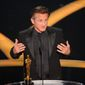 """Sean Penn accepts the Oscar for best actor for his work in """"Milk"""" during the 81st Academy Awards Sunday. (AP Photo/Mark J. Terrill)"""