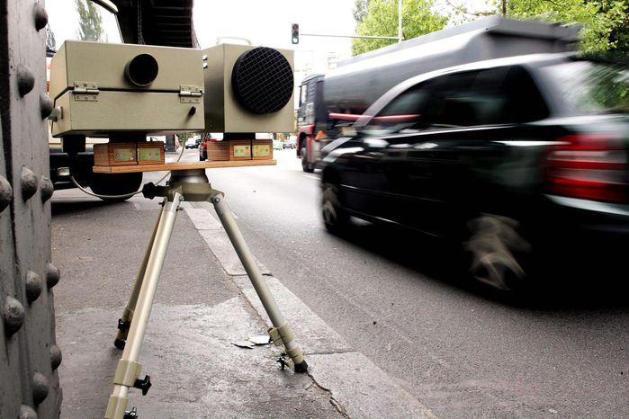 BERLIN - AUGUST 30: A speed camera of the German police monitors speeding automobile drivers on a busy street August 30, 2006 in Berlin, Germany. Germany has stringent laws on speeding and most German drivers experience a suspension of their licence at some point in their lives. Some politicians are debating whether to scrap licence suspensions for less serious speeding in favour of higher monetary fines. (Photo by Sean Gallup/Getty Images)
