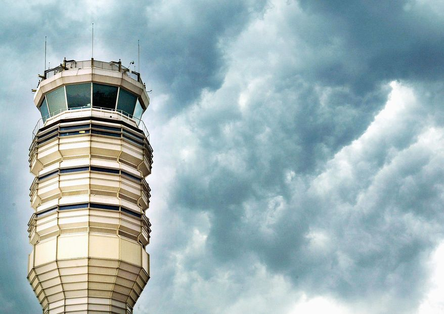 Clouds gather over the control tower at Ronald Reagan Washington National Airport in Arlington. (Getty Images file)