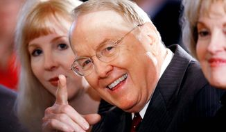 NUMBER ONE: Focus on the Family's James Dobson waves and smiles recently as his wife, Shirley (right), looks on. (Getty Images)