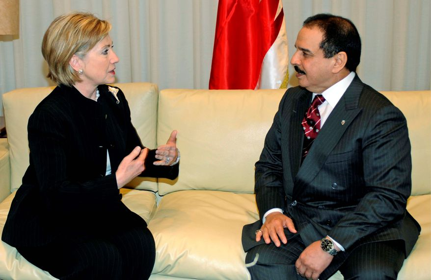 ** FILE ** U.S. Secretary of State Hillary Rodham Clinton meets with Bahraini King Hamad bin Isa al-Khalifa on the sidelines of the Egypt-hosted international conference on rebuilding Gaza, in Sharm el-Sheik, Egypt, in March 2009. (AP Photo/U.S. Embassy in Egypt, Sameh Refaat)