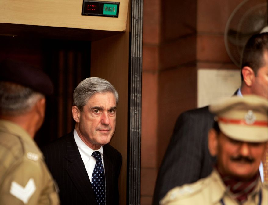 FBI Director Robert Mueller arrives for a meeting at the Indian Home Ministry in New Delhi, India, on Tuesday. Associated Press