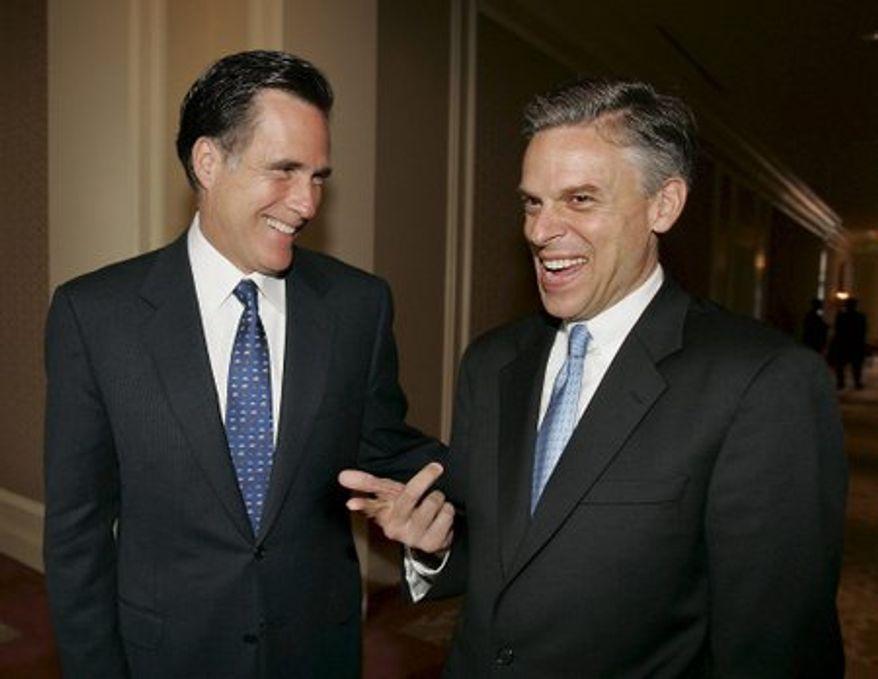 Former Massachusetts Gov. Mitt Romney (left) and former Utah Gov. Jon Huntsman