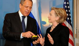 "Former Secretary of State Hillary Rodham Clinton presents Russian Foreign Minister Sergey Lavrov with a ""reset button"" during their meeting in Geneva in 2009. (Associated Press) ** FILE **"