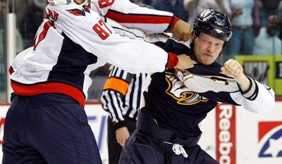 Associated Press File Former Capitals left wing Donald Brashear fights with Predators right wing Wade Belak.