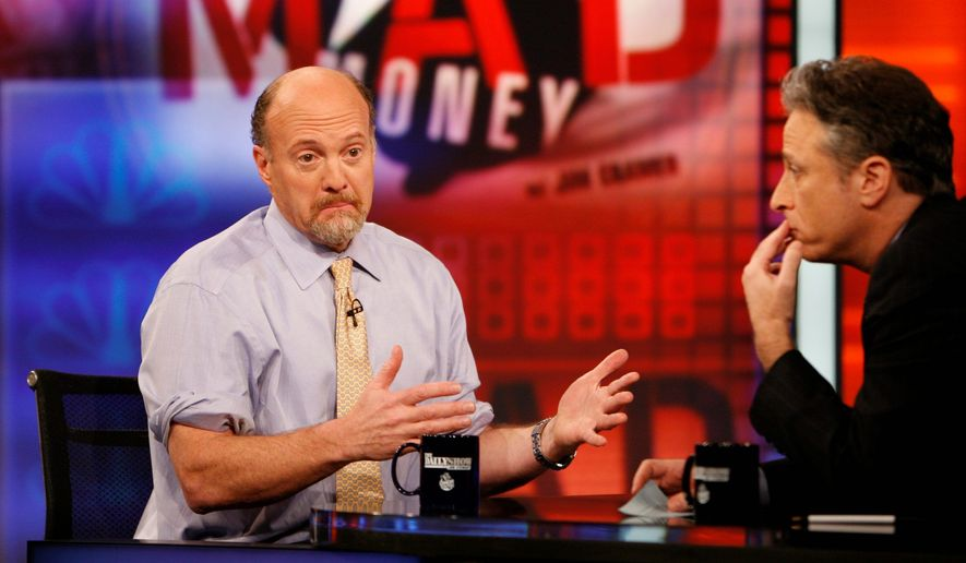 "Jim Cramer (left), host of CNBC's ""Mad Money"" show, talks with Jon Stewart on Comedy Central's ""The Daily Show with Jon Stewart."" (Associated Press)"