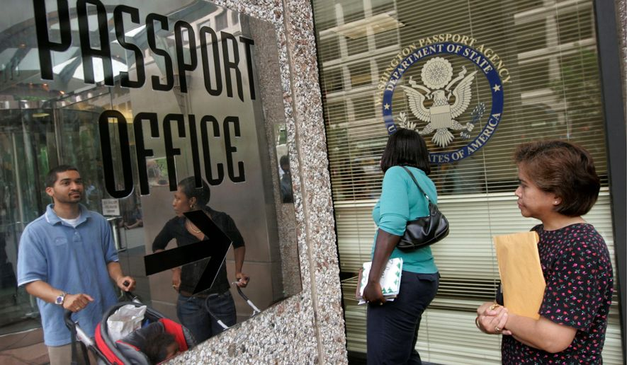 People wait in line outside the U.S. Passport Office in downtown Washington in this file photo. (Associated Press)