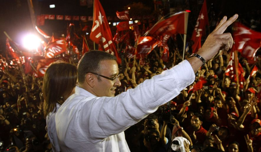 Mauricio Funes, presidential candidate of the Farbundo Marti National Liberation Front party (FMLN), gestures as he gives his victory speech after winning the election in San Salvador, Sunday, March 15, 2009. (AP Photo/Luis Romero)
