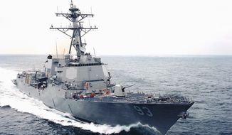 U.S. NAVY The USS Chung-Hoon sails the Gulf of Mexico during her builder's sea trials in 2004. Last week, the destroyer came to the aid of a U.S. ocean surveillance ship being harassed by Chinese vessels in the South China Sea.