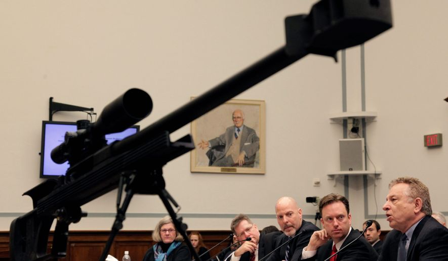 With .50-caliber rifle in the foreground, Tom Diaz, senior policy analyst, Violence Policy Center, right, testifies on Capitol Hill in Washington, Thursday, March 12, 2009, before the House National Security and Foreign Affairs subcommittee hearing on U.S.-Mexico border violence. (AP Photo/Alex Brandon) ** FILE **
