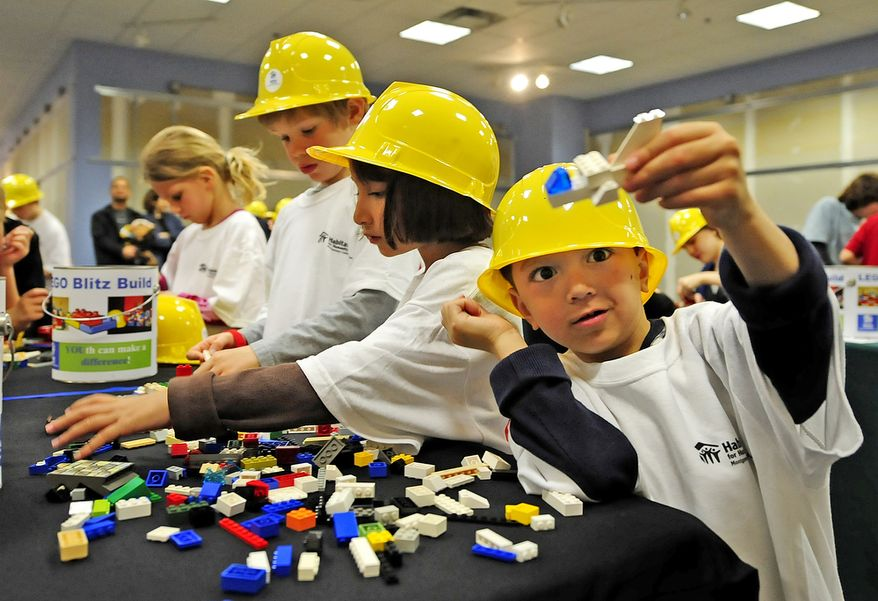 Andy Zarate enjoys his Lego airplane as his sister Katie gets started. Children between 7 and 17 were given 400 pieces to build with at the Montgomery Mall in Bethesda, Md, Sunday. (Joseph Silverman/ The Washington Times)