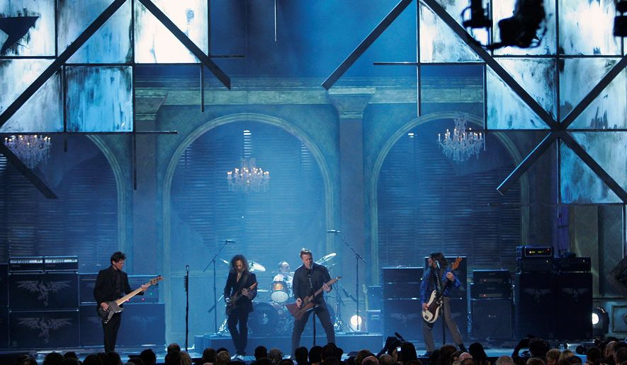 In this file photo, Metallica perform after the Rock and Roll Hall of Fame Induction. Alameda County, Calif.,  has designated Feb. 10, 2018, as Cliff Burton Day in honor of the band's original bass guitarist who died in a 1986 bus crash. (Associated Press) **FILE**
