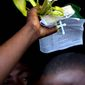 A woman holds palm fronds and a Bible during Palm Sunday celebrations in Port-au-Prince, Haiti.   (AP Photo/Ramon Espinosa)