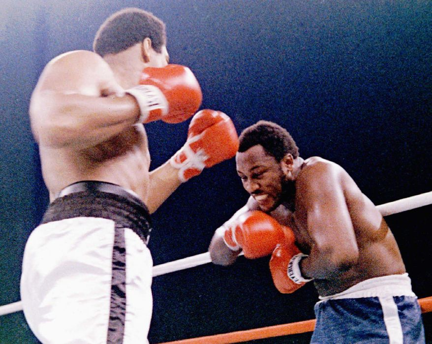 Joe Frazier (right) and Muhammad Ali met for their third - and most physical - match in Manila in 1975. (Associated Press)