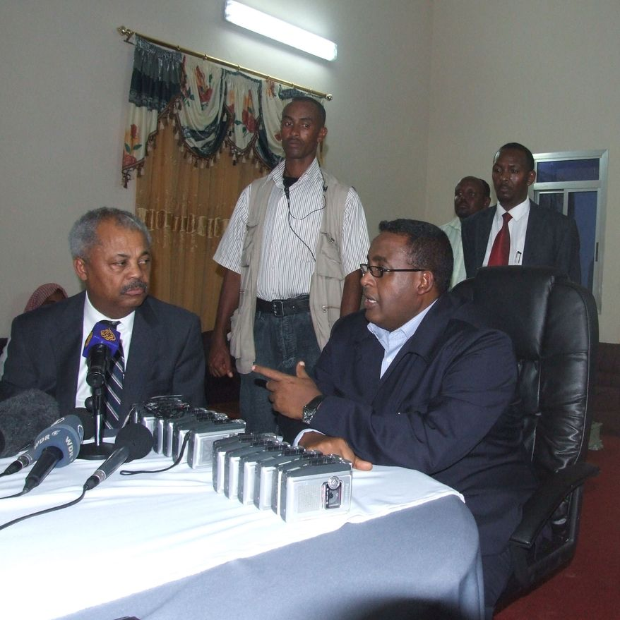 ** FILE ** U.S. Rep. Donald Payne (left) has discussions with Somali Prime Minister Omar Abdirashid on Monday, April 13, 2009, in the Somali capital, Mogadishu. (AP Photo/Mohamed Sheikh Nor)