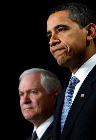 **FILE** President Obama and Defense Secretary Robert M. Gates (Associated Press)
