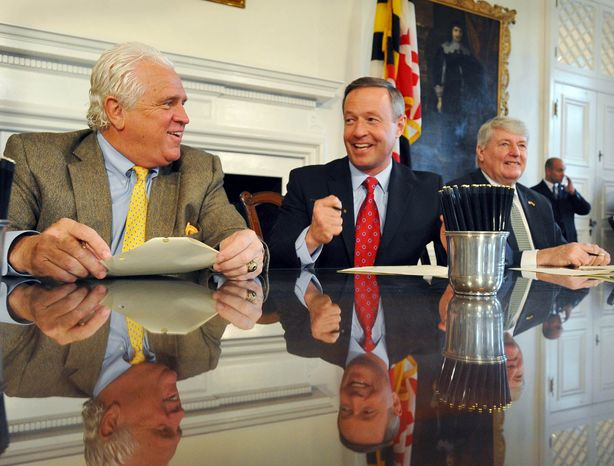 After the end of the General Assembly session in Annapolis, Gov. Martin O'Malley (center) signs a bill into law Tuesday with Speaker of the House Michael E. Busch (right) and Senate President Thomas V. Mike Miller Jr. in attendance. One new law gives Maryland first chance to buy the Preakness horse race to keep it in the state. (Associated Press)
