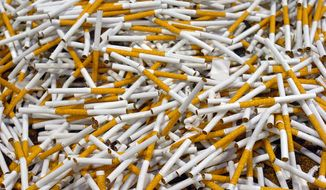 **FILE** In this 2008 photo, cigarettes run through one of the production lines at the General Tobacco facility in Madison, N.C. (Associated Press/Winston-Salem Journal)