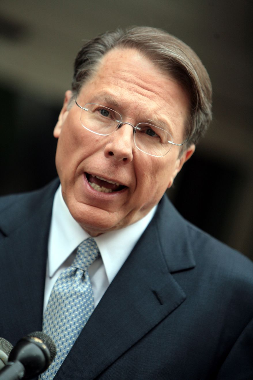 """In this photo released by CBS, NRA Executive Vice President Wayne LaPierre talks to reporters after his appearance on the CBS talk show """"Face the Nation"""" on Sunday, April 19, 2009, in Washington. (AP Photo/CBS' """"Face the Nation,"""" Karin Cooper)"""