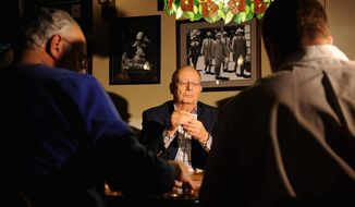 Former Sen. Alfonse M. D'Amato glances at his cards during his regular card game at Oheka Castle in Huntington, N.Y. (Associated Press) ** FILE **