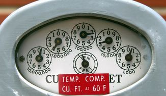 A meter's dials indicate cubic feet of natural gas consumed. Higher utility bills have left many people behind on payments, including in Maryland, where 120,000 customers are in arrears and the Public Service Commission is investigating. (Getty Images)