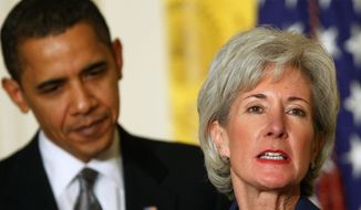 **FILE** President Barack Obama with Health and Human Services Secretary Kathleen Sebelius (Associated Press)