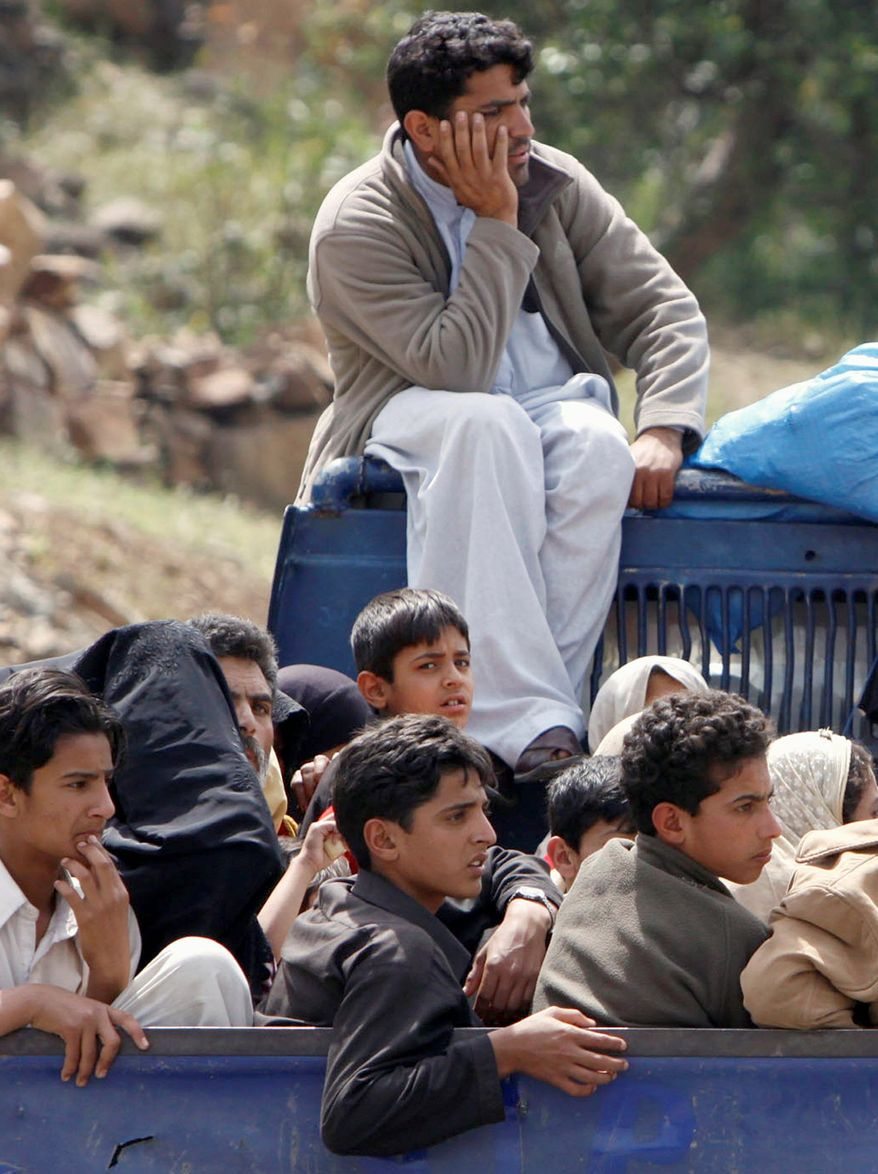 "Local residents on Monday flee Pakistan's Lower Dir district, where Pakistani security forces launched an operation against militants. The Taliban said their peace deal with the Pakistani government was ""worthless."""