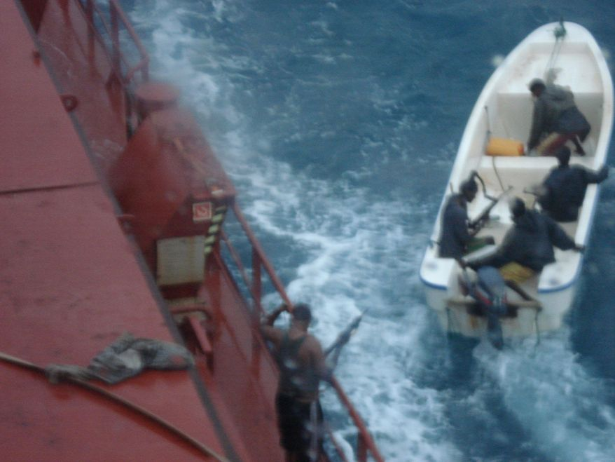 Somali pirates depart from an unidentified seized ship in this undated photo.
