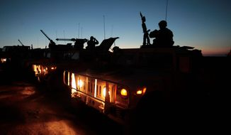 Soldiers mount up on their Humvees as the sun rises in the Mohave Desert while they prepare for a live-fire training mission at the National Training Center at Fort Irwin, Calif. ** FILE **
