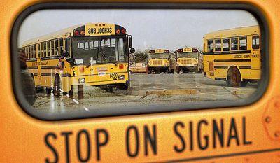 THE WASHINGTON TIMES FILE School buses.