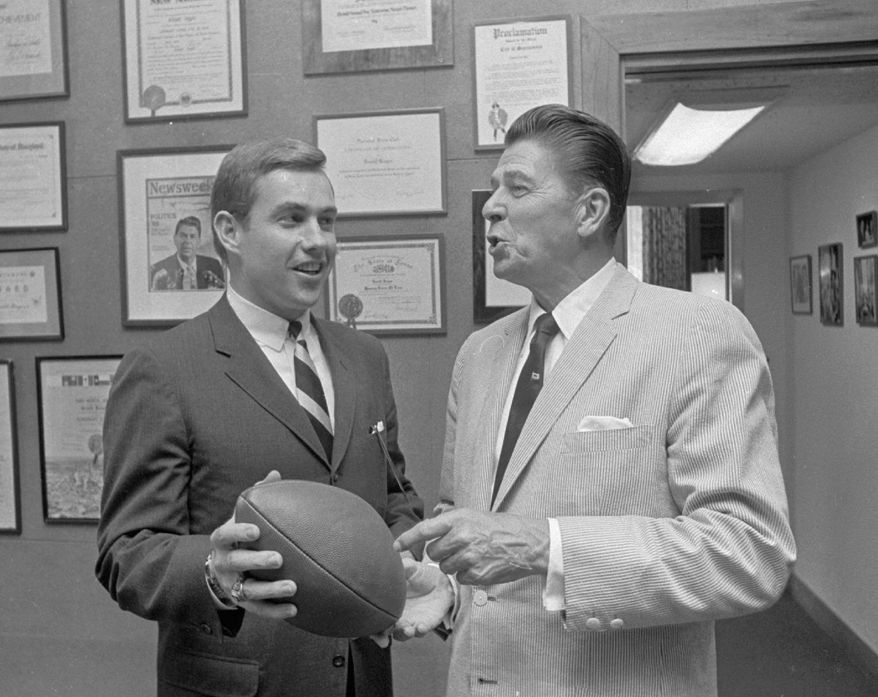 "ASSOCIATED PRESS Jack Kemp trades football jabs with then-California Gov. Ronald Reagan in his Sacramento office in 1967. Mr. Kemp, a former quarterback and congressman, has been called one of Reagan's ""biggest cheerleaders."""