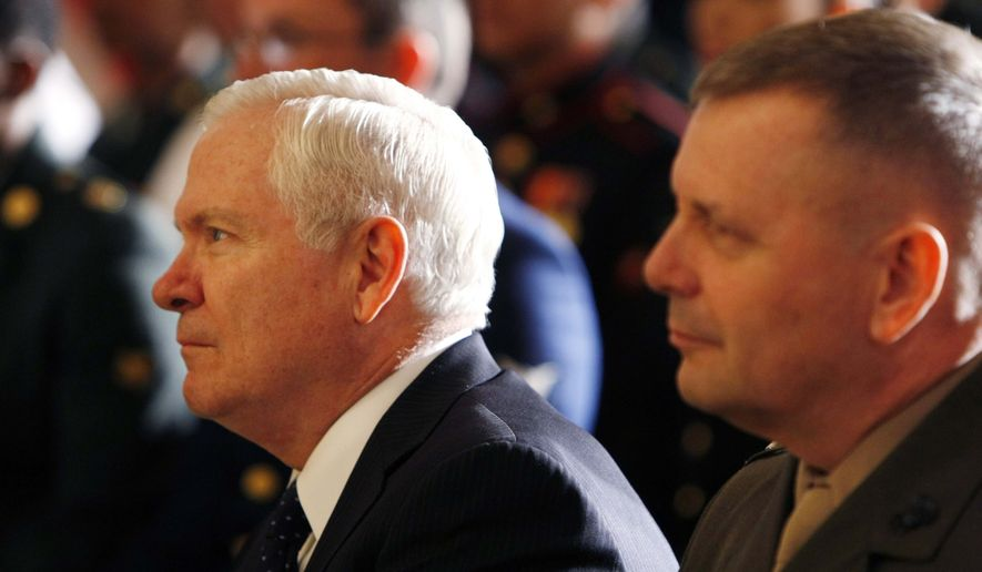 ** FILE ** Defense Secretary Robert M. Gates (left) and Gen. James E. Cartwright, vice chairman of the Joint Chiefs of Staff, listen as President Obama and Homeland Security Secretary Janet Napolitano hold a naturalization ceremony for active-duty service members in the East Room of the White House in Washington on Friday, May 1, 2009. (AP Photo/Gerald Herbert, File)