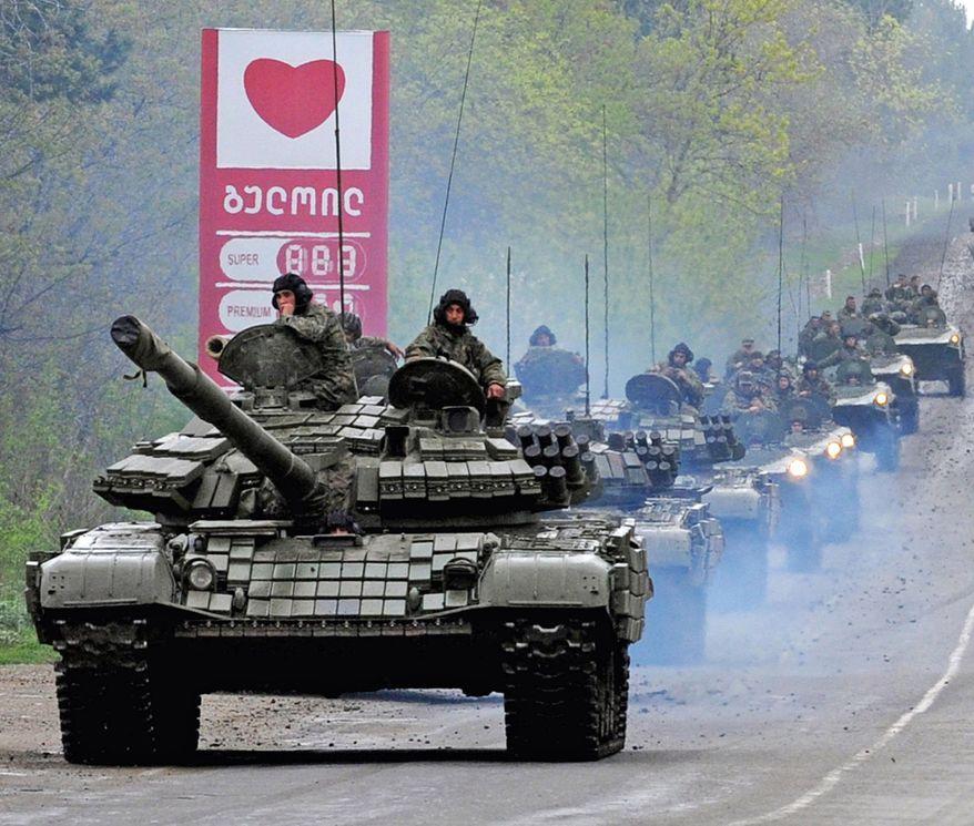 Georgian tanks move along a road outside the capital, Tbilisi.