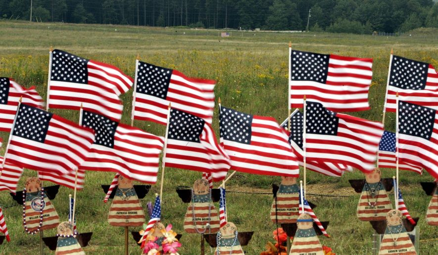 A display of flags in Shanksville, Pa., stand in memory of the 40 passengers and crew members of United Flight 93 who were killed on Sept. 11, 2001. A permanent memorial is planned by the 10th anniversary of the terrorist attack. (Associated Press/File)