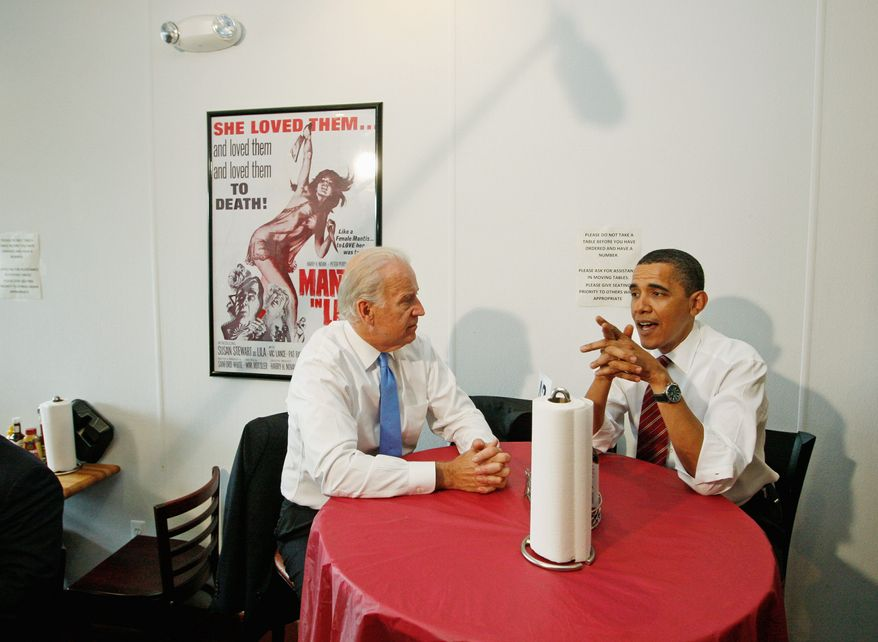 President Barack Obama and Vice President Joe Biden wait for their burgers as they make an unannounced visit to Ray's Hell Burger in Arlington, Va., to have lunch, Tuesday, May 5, 2009. (AP Photo/Charles Dharapak)