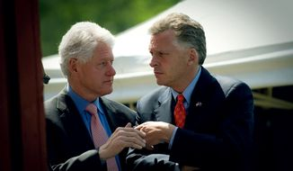 ** FILE ** Virginia Democratic gubernatorial candidate Terry McAuliffe (right) confers with former President Bill Clinton at a campaign rally in Herndon, Va., in 2009. (The Washington Times)
