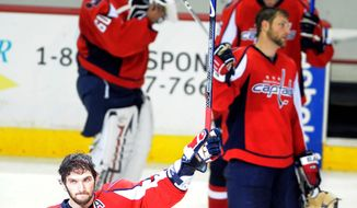 "Michael Connor/The Washington Times Alex Ovechkin (lower left) of the Washington Capitals acknowledges fans Wednesday night after the Pittsburgh Penguins defeated the Caps 6-2 in the seventh and deciding game of the NHL's Eastern Conference semifinals at the Verizon Center. ""We're disappointed,"" Ovechkin said of the season-ending loss."