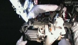 ASSOCIATED PRESS Spacewalking astronauts struggle against minor problems Sunday to upgrade and repair the Hubble Space Telescope. The second part of the spacewalk had to be abandoned after they spent nearly two hours on a stubborn bolt.