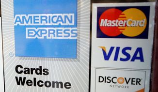 Credit-card stickers announce a variety of options for charging the cost of a visit to a bowling alley in Palo Alto, Calif.