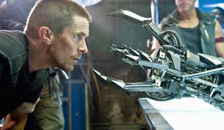 "** FILE ** Christian Bale gets a closer look at the Hydrobot Terminator in the movie ""Terminator Salvation."" (Associated Press)"