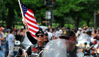 photographs by rod lamkey jr./the washington times Artie Muller, a Vietnam veteran and Rolling Thunder's national executive director, leads the pack of an estimated 500,000 motorcyclists, from all 50 states and from as far away as Australia, during the organization's 22nd annual Ride for Freedom along Constitution Avenue on Sunday.
